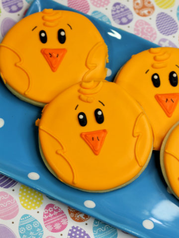 Round Sugar Cookie Decorated with yellow royal icing to look like easter chicks