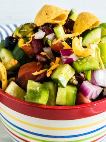Picnic Salad; corn, kidney beans, cucumber, red onion, zucchini tossed in Catalina dressing