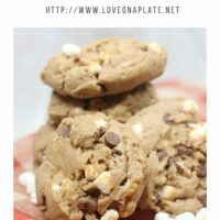 Milk Chocolate Cookies with mini marshmallows, chocolate chip cookies piled up on a red checked tea towel
