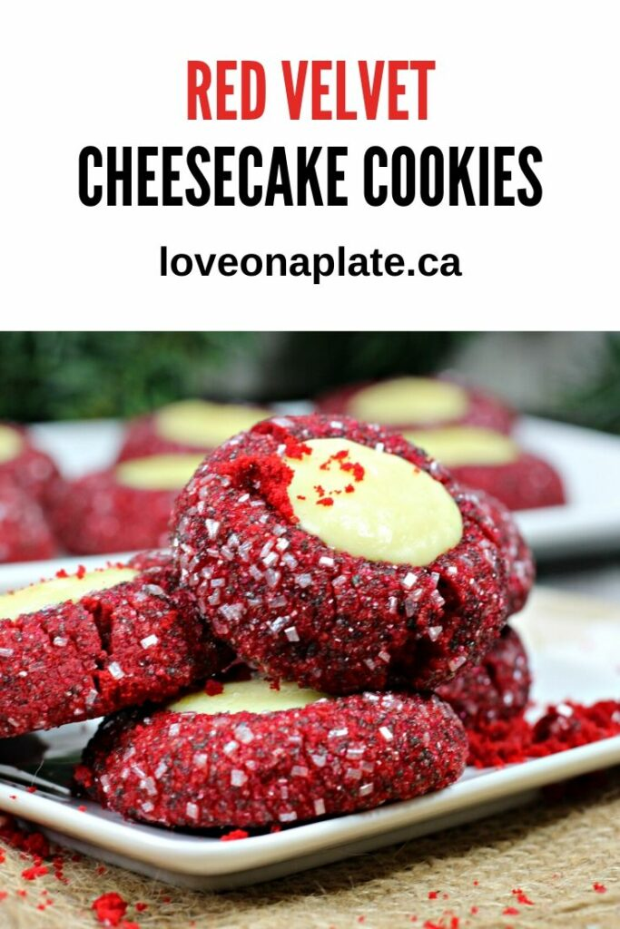 Red Velvet Thumbprint cookies rolled in sanding sugar and filled with cheesecake on a white cookie platter.